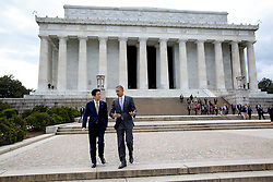 President Barack Obama and Prime Minister Shinzo Abe of Japan depart the Lincoln Memorial in Washington, D.C., April 27, 2015. (Official White House Photo by Pete Souza)<br /> <br /> This official White House photograph is being made available only for publication by news organizations and/or for personal use printing by the subject(s) of the photograph. The photograph may not be manipulated in any way and may not be used in commercial or political materials, advertisements, emails, products, promotions that in any way suggests approval or endorsement of the President, the First Family, or the White House.