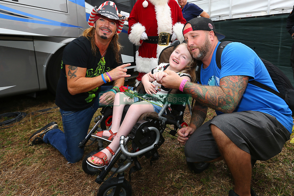 Bret Michaels meets some of the children from The Joe DiMaggiao's Children's Hospital before his performance at the 2018 SFPC Toys in The Sun Run. The event has raised millions of dollars and hundreds of thousand toys over the years for The Joe DiMaggio's Children's Hospital. Approximately 35,000 bikers ride in the 20 mile motorcycle ride and even more attend the festival afterwards. This year Bret Michaels made a $5,000 donation on top of several donations he already made from his Life Rocks Foundation to the Joe DiMaggio's Children's Hospital. Prior to his performance Bret personally handed out roses to the children who are undergoing treatments at the Joe DiMaggio's Children's Hospital, he also snapped a group photo with the children and their families as well as a few with Elmo and Cookie Monster. 09 Dec 2018 Pictured: Bret Michaels. Photo credit: Ralph Notaro / MEGA TheMegaAgency.com +1 888 505 6342