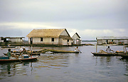 Shops on boats in informal housing wooden shacks built on timber logs known as the Floating City, Manaus, Brazil 1962