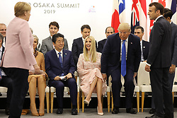 """Angela Merkel (German Chancellor), Queen Maxima of the Netherlands, Shinzo Abe (Japanese Prime Minister), Ivanka Trump (Advisor to the President of the United States), Donald J. Trump (US President), Emmanuel Macron (French President) - Side event organized by the Japanese Prime Minister, on the theme """"Promoting the place of women at work"""" at the Intex Osaka congress center at the G20 summit in Osaka, Japan, on June 29, 2019. Photo by Dominque Jacovides/Pool/ABACAPRESS.COM"""