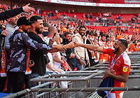 Blackpool's Keshi Anderson celebrates with friends after the match<br /> <br /> Photographer Chris Vaughan/CameraSport<br /> <br /> The EFL Sky Bet League One Play-Off Final - Blackpool v Lincoln City - Sunday 30th May 2021 - Wembley Stadium - London<br /> <br /> World Copyright © 2021 CameraSport. All rights reserved. 43 Linden Ave. Countesthorpe. Leicester. England. LE8 5PG - Tel: +44 (0) 116 277 4147 - admin@camerasport.com - www.camerasport.com