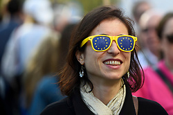 © Licensed to London News Pictures. 20/10/2018. LONDON, UK. A woman wears Europe inspired sungalsses. Thousands of people take part in a demonstration, organised by the People's Vote campaign, beginning with a march from Park Lane to a rally in Parliament Square.  The People's Vote seeks a referendum on the outcome of the final Brexit negotiations ahead of 29 March 2019, the date that the UK is due to leave the EU.  Photo credit: Stephen Chung/LNP