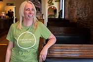 Mandy Estrella, owner of Mayo Ketchup by Plantain Girl, poses for a photograph in the restaurant's dining room Thursday, Nov. 14, 2019 in the Lafayette Square neighborhood of St. Louis. The fast casual restaurant serves Puerto Rican, Dominican and Cuban food. Photo © copyright 2019 Sid Hastings.