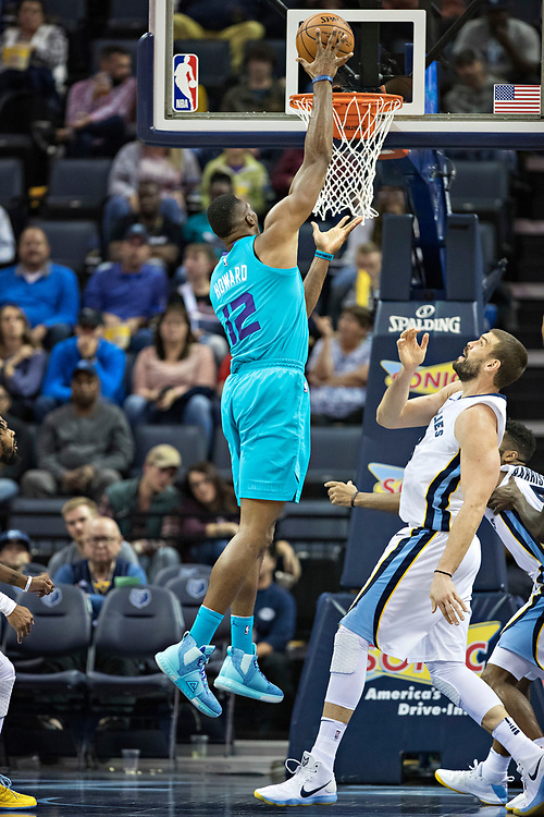 MEMPHIS, TN - OCTOBER 30:  Dwight Howard #12 of the Charlotte Hornets goes up for a dunk over Marc Gasol #33 of the Memphis Grizzlies at the FedEx Forum on October 30, 2017 in Memphis, Tennessee.  NOTE TO USER: User expressly acknowledges and agrees that, by downloading and or using this photograph, User is consenting to the terms and conditions of the Getty Images License Agreement.  The Hornets defeated the Grizzlies 104-99.  (Photo by Wesley Hitt/Getty Images) *** Local Caption *** Dwight Howard; Marc Gasol