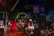 Night scene in Siem Reap as local people enjoy the annual Water Festival.
