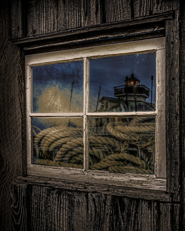 Reflection of St Micheals light house in shed window