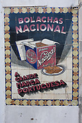 Detail of an old advert made from traditional Portuguese ceramic tiles, for the large cookie and biscuit brand Bolaches Nacional , on 17th July, at Coimbra, Portugal. Nowadays, Nacional make all varieties of biscuit - including shortcake and crackers.