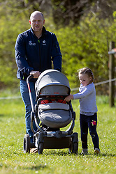 Mike Tindall with his daughters Mia (right) and Lena Elizabeth (in buggy) at the Land Rover Gatcombe Horse Trials, on Gatcombe Park, Gloucestershire.
