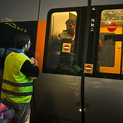 A volunteer at CPH Airport train station communicate through a locked door with refugees onboard to make sure they are alright. The train is on the way to Sweden and safety.  An unprecedented number of refugees arrived from Germany in early September, most being Syrian war refugees, some from Afghanistan. Most wanted to travel on to Sweden and a number of Danish citizens created a spontanious network to assist the refugees with travel, food, clothes and psycological support.