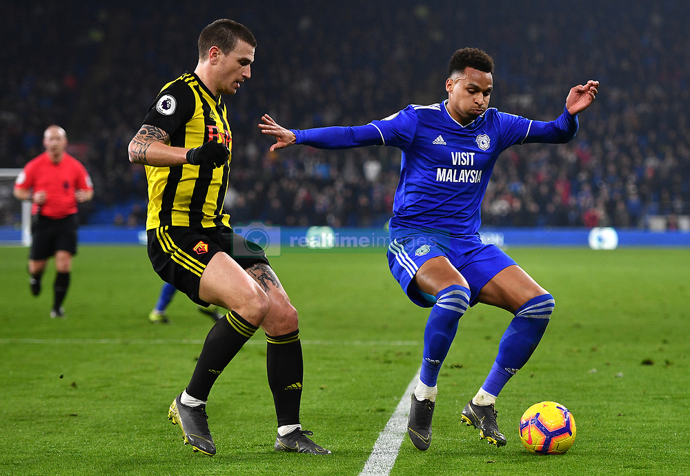 Watford's Daryl Janmaat (left) and Cardiff City's Josh Murphy battle for the ball during the Premier League match at the Cardiff City Stadium.