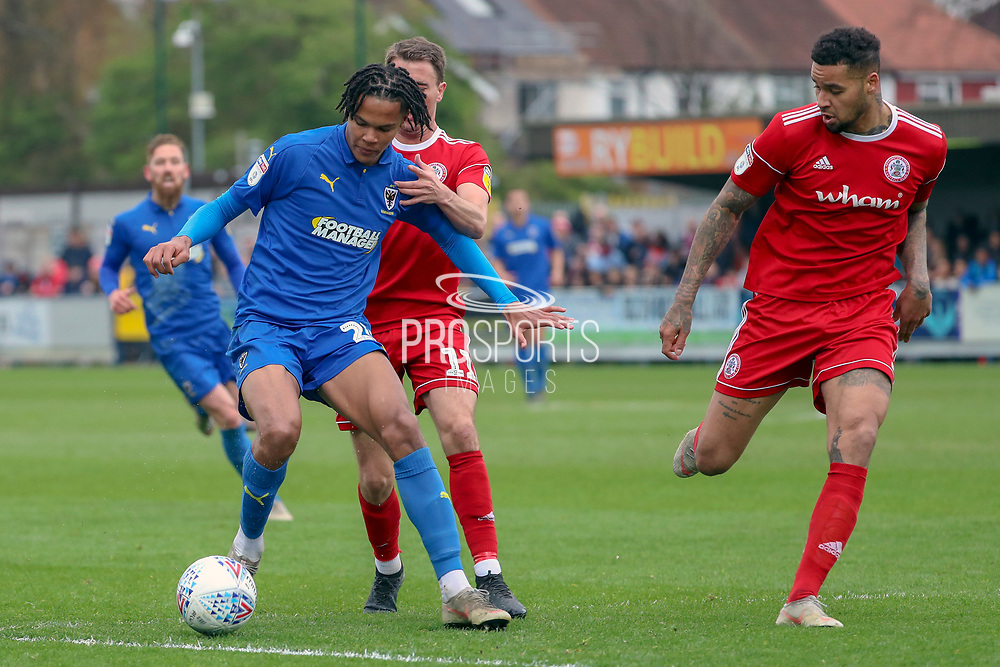 AFC Wimbledon defender Toby Sibbick (20) dribbling during the EFL Sky Bet League 1 match between AFC Wimbledon and Accrington Stanley at the Cherry Red Records Stadium, Kingston, England on 6 April 2019.