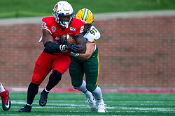 NORMAL, IL - October 05: Derrek Tuszka works to stop the advance of James Robinson during a college football game between the ISU (Illinois State University) Redbirds and the North Dakota State Bison on October 05 2019 at Hancock Stadium in Normal, IL. (Photo by Alan Look)
