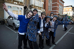 © Licensed to London News Pictures. 26/02/2021. London, UK. Ultra-Orthodox Jewish children wear costumes to celebrate the Jewish Purim holiday in the Stamford Hill area of north London.The festival involves the reading of the Book of Esther, describing the defeat of Haman, the Persian king's adviser, who plotted to massacre the Jewish people 2,500 years ago, an event that was prevented by Esther's courage. The festival of Purim is celebrated every year on the 14th of the Hebrew month of Adar in the Jewish calendar has just begin. Photo credit: Marcin Nowak/LNP