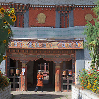 Asia, Bhutan, Bumthang. Bhutanese man at Jambay Lhakhang, a Buddhist temple dating back to the 7th century.