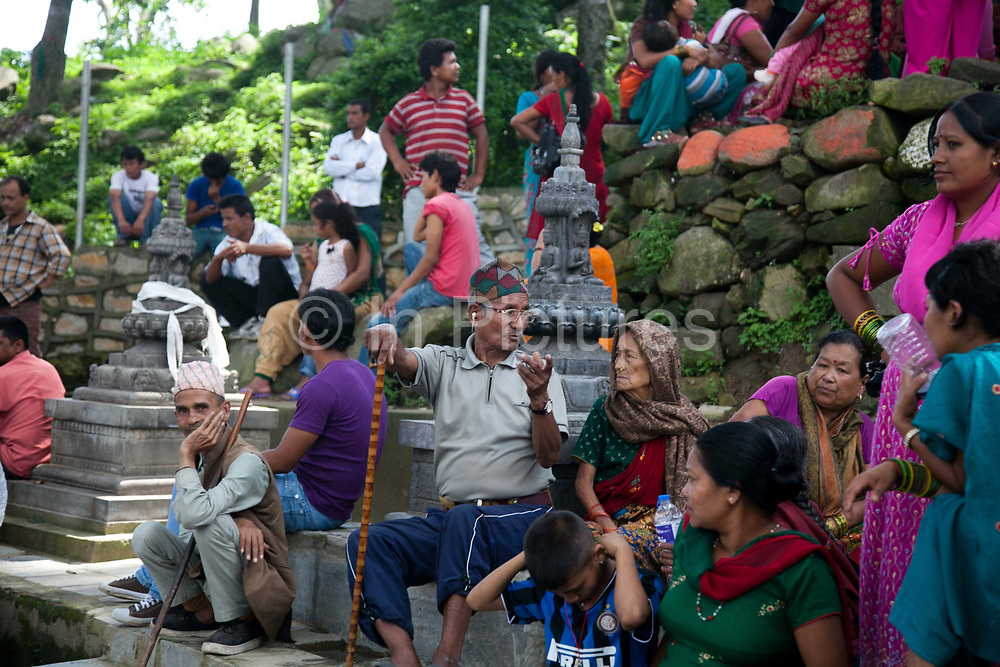 A large crowd of festival goers have gathered on the steps below the Wayambhunath temple complex, also called the Monkey Temple.