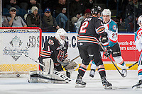 KELOWNA, CANADA - FEBRUARY 1: Calvin Thurkauf #27 of the Kelowna Rockets scores a first period goal on Trevor Martin #1 of the Calgary Hitmen on February 1, 2017 at Prospera Place in Kelowna, British Columbia, Canada.  (Photo by Marissa Baecker/Shoot the Breeze)  *** Local Caption ***