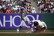 Los Angeles Dodgers second baseman Chris Taylor (3) makes a double play as San Francisco Giants left fielder Brandon Belt (9) slides into second base at AT&T Park in San Francisco, California, on April 27, 2017. (Stan Olszewski/Special to S.F. Examiner)