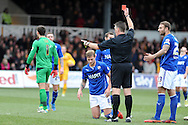 Chesterfield's Liam Cooper (on ground) is sent off by referee Mark Haywood.  Skybet football league two match, Newport county v Chesterfield at Rodney Parade in Newport, South Wales on Sunday 1st Dec 2013. pic by Andrew Orchard, Andrew Orchard sports photography,