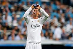 Cristiano Ronaldo of Real Madrid sprays his face with water - Mandatory byline: Rogan Thomson/JMP - 04/05/2016 - FOOTBALL - Santiago Bernabeu Stadium - Madrid, Spain - Real Madrid v Manchester City - UEFA Champions League Semi Finals: Second Leg.