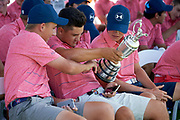 AJGA athletes pass around the Claret Jug which Jordan Spieth won during the 2017 Open Championship while Spieth leads a workshop the Under Armour® / Jordan Spieth Championship presented by American Campus Communities at Trinity Forest Golf Club in Dallas, Texas on August 15, 2017. CREDIT: Cooper Neill for The Wall Street Journal<br /> JRGOLF