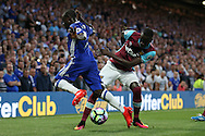 Cheikhou Kouyate of West Ham United tackles Ngolo Kante of Chelsea. Premier league match, Chelsea v West Ham United at Stamford Bridge in London on Monday 15th August 2016.<br /> pic by John Patrick Fletcher, Andrew Orchard sports photography.