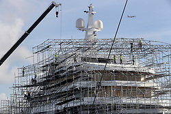 Construction workers dismantle scaffolding that encompasses a yacht under construction at Harbor Towne Marina in Dania Beach ahead of Hurricane Irma. Photo by Mike Stocker /Sun Sentinel/TNS/ABACAPRESS.COM