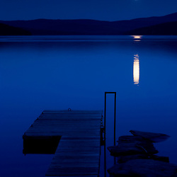 A full moon rises over Lake Francis in Pittsburg, New Hampshire.