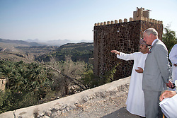 The Prince of Wales during a walking tour of the Misfat Al Abriyeen village, which was built over 200 years ago and is a traditional Omani village, complete with agricultural terraces along the mountain slopes and traditional mud houses built with carved wooden doors, palm frond roofs and solid rock foundations.