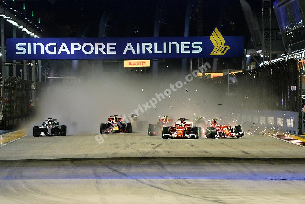 Ferrari drivers Sebastian Vettel and Kimi Raikkonen crash at the start of the 2017 Singapore Grand Prix at the Marina Bay circuit. Photo: Grand Prix Photo