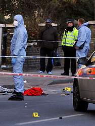 © Licensed to London News Pictures. 19/02/2012, London, UK. The scene at Stanstead Road today 19 February 2012. A forensic officer stands over First aid equipment and a red blanket. Police have shot a man in Forest Hill, London with firearms and a taser. A man is in a critical condition after being shot by police in south-east London. Police were called to reports of a man trying to break into a car in Elsinore Road, Forest Hill, in the early hours.. Photo credit : Stephen Simpson/LNP