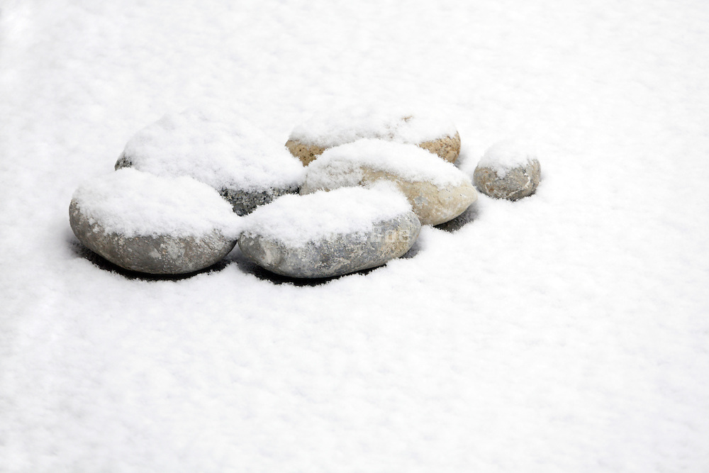 fresh pristine and untouched snow with some round pebbles