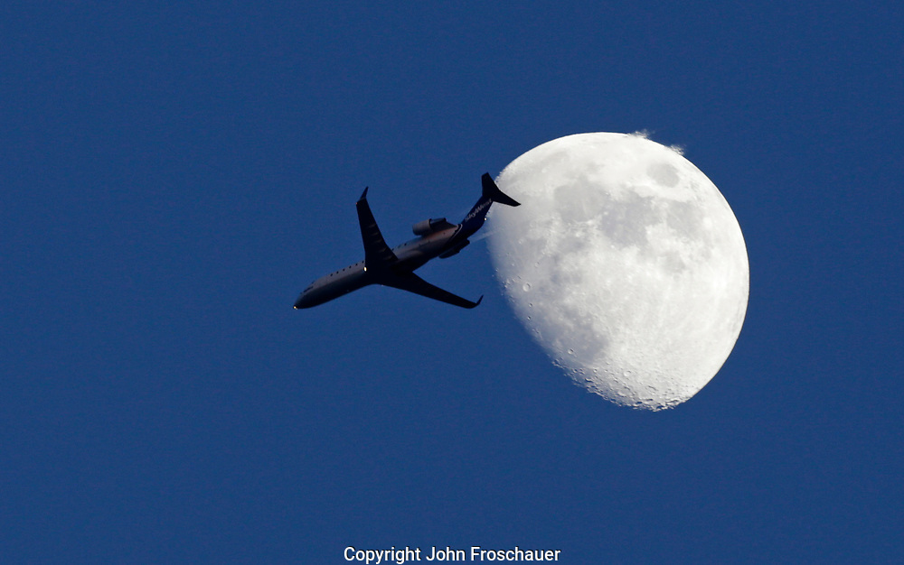 Airplane passing in front of the moon as seen from Tacoma WA. (Photo: John Froschauer)
