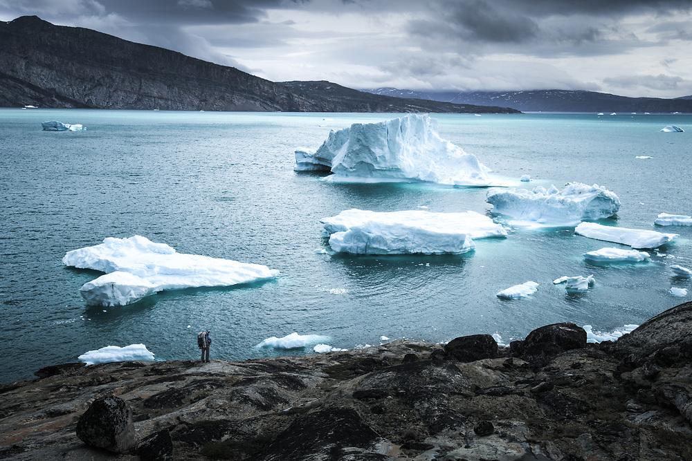 Watching the icebergs at Uummannaq Fjord, North Greenland