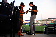Rep. Rosa DeLauro, D-Conn, left, talks with Sen. Chris Murphy, D-Conn., right, during a watch party for the Democratic National Convention at Dunkin' Donuts Park, home of the Hartford Yard Goats minor league baseball team, Thursday, Aug. 20, 2020, in Hartford, Conn. (AP Photo/Jessica Hill)