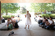 Photos of professor Anne Buttimer teaching outside.
