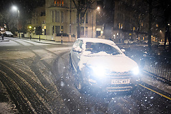 © Licensed to London News Pictures. 01/02/2019. London, UK. A car navigates through heavy snowfall in Maida Vale, West London as large parts of the UK are deluged with snow and freeing temperatures. Photo credit: Ben Cawthra/LNP