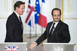59680172  .French President Francois Hollande (R) and visiting British Prime Minister David Cameron attend a joint press conference at the Elysee Palace in Paris, France, May 22, 2013. French President Francois Hollande and British Prime Minister David Cameron on Wednesday condemned the assassination of a British soldier in the suburbs of London after their meeting in Paris, France, May 22, 2013. Photo by: imago / i-Images. UK ONLY