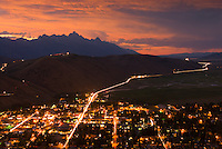 A fiery sunset lights the sky over the Tetons and Town of Jackson in Jackson Hole, Wyoming.