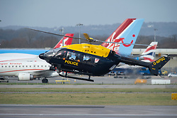 © Licensed to London News Pictures. 20/12/2018. Gatwick, UK.Police helicopter low flying round the runway looking for the drone. Drone has closed Gatwick airport with all flights in and out cancelled while police hunt for drone pilot deliberately targeting airport.Photo credit: Grant Falvey/LNP
