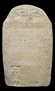 Stele of Horemkhauef. Limestone  Dynasty 13 (ca. 1700 B.C.) From the tomb of Horemkhauef at Hierakonpolis. Horemkhauef lived in the southern Egyptian town of Hierakonpolis during the end of the Middle Kingdom, shortly before the capital city of Lisht was abandoned to the Hyksos. He was an official in charge of the measurement of fields for the purposes of taxation, but he also served as a priest in the local temple of Horus, the patron god of Hierakonpolis. Horemkhauef's stele, erected in his tomb, is unusual for its description of a mission on which he was sent to the capital to bring back for his temple a cult statue of Horus and Isis, which he had crafted in the royal workshops.