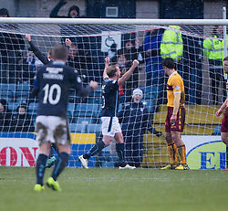 Dundee's Gary Irvine cele scored their third goal.<br /> half time : Dundee 3 v 1 Motherwell, SPFL Premiership played 10/1/2015 at Dundee's home ground Dens Park.