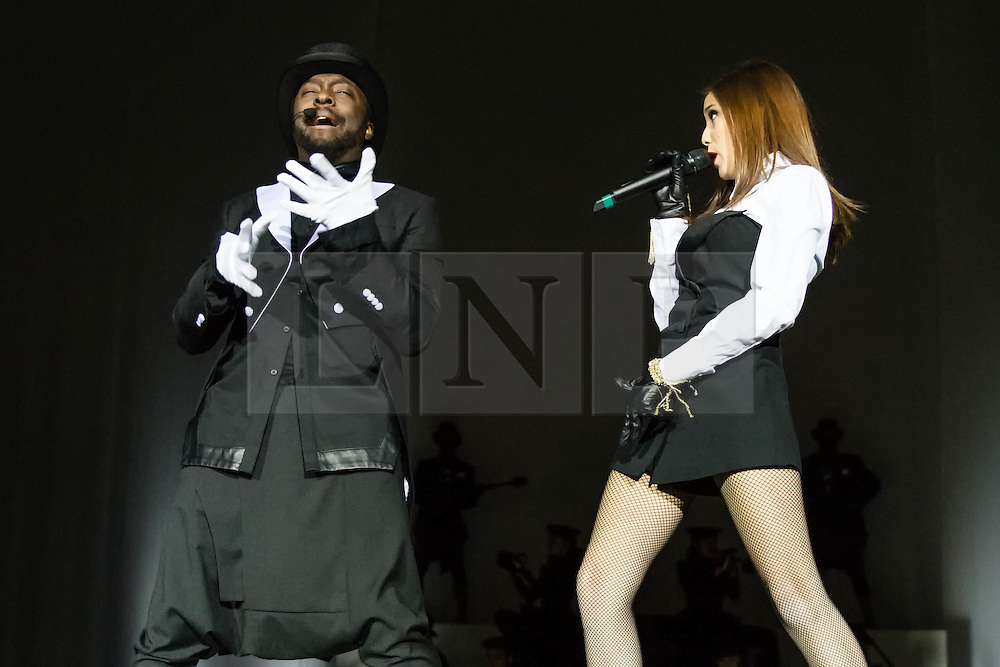 © Licensed to London News Pictures. 05/12/2013. London, UK.   Will.i.am performing live at The O2 Arena. Will.i.am (real name William James Adams),  is an American recording artist, songwriter, entrepreneur, voice actor, DJ, record producer, and philanthropist, best known as one of the founding members of the hip hop/pop band, The Black Eyed Peas. He is the recipient of seven Grammy Awards, eight American Music Awards, a Billboard Music Award, a Teen Choice Award, two MTV Video Music Awards, and three World Music Awards all won with the Black Eyed Peas. Photo credit : Richard Isaac/LNP