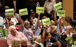 June 3, 2017 - San Juan Capistrano, California, United States - June 3, 2017_San Juan Capistrano, California_USA_  At the Representative Issa Town Hall Meeting at San Juan Hills High School anti-Trump audience members holds signs agreeing with an audience member speaking against Trump.  _Photo Credit: Photo by Charlie Neuman (Credit Image: © Charlie Neuman via ZUMA Wire)