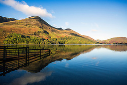 © Licensed to London News Pictures. 02/10/2016. Buttermere UK. Picture shows the mountains reflecting into the still water of Buttermere lake in Cumbria at sunrise this morning. Photo credit: Andrew McCaren/LNP