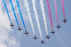 © Licensed to London News Pictures. 10/05/2015. London, UK. A fly-by by the Red Arrows after war veterans and servicemen parade through Whitehall as part of the VE Day, 70th anniversary celebrations. Photo credit : Stephen Chung/LNP