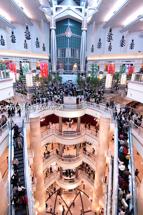 Interior of large modern shopping mall attached to Taipei 101 one of the worlds tallest buildings in Taipei Taiwan