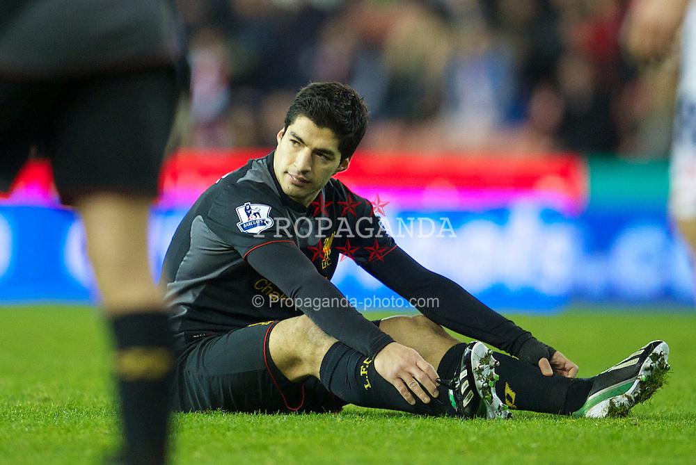 STOKE-ON-TRENT, ENGLAND - Boxing Day Wednesday, December 26, 2012: Liverpool's Luis Alberto Suarez Diaz looks dejected after missing a chance against Stoke City during the Premiership match at the Britannia Stadium. (Pic by David Rawcliffe/Propaganda)