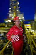 Oswaldo Gutierrez, Chief of the PDVSA Oil Platform GP 19 in Lake Maracaibo, Venezuela, works on the platform for seven days then is off at home for seven days.  Seen in various places with other workers. Model Released..