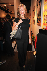 Model GEMMA ATKINSON at a private view of an exhibition of work by artists Zoobs and Lodola held at The Opera Gallery, 134 New Bond Street, London on 16th June 2010.