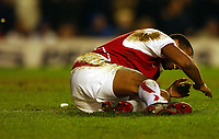 Photo. Javier Garcia<br />08/03/2003 Arsenal v Chelsea, FA Cup Quarter Final, Highbury<br />Thierry Henry ducks as a lighter sits beside him and a one pound coin, top left, flies towards him thrown from the end where CHelsea fans were sitting